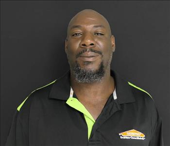 Male African American with black beard and black SERVPRO shirt