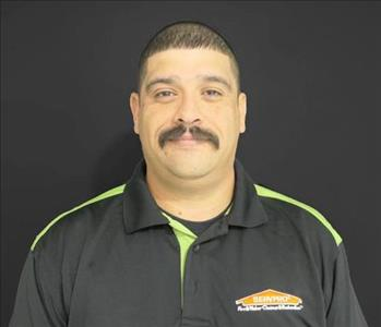 White male with mustache wearing black SERVPRO shirt