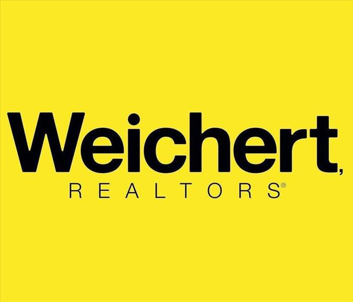 Weichert Realtors writing with yellow background