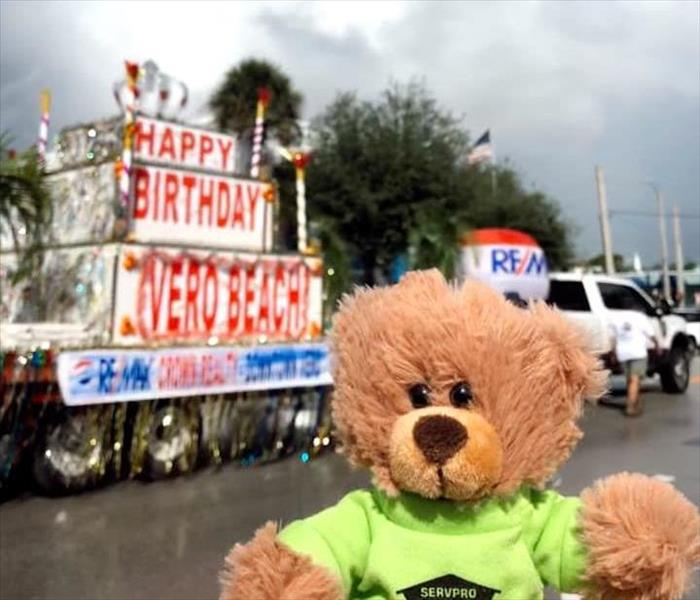 SERVPRO Teddy in a green shirt at Vero Beach parade