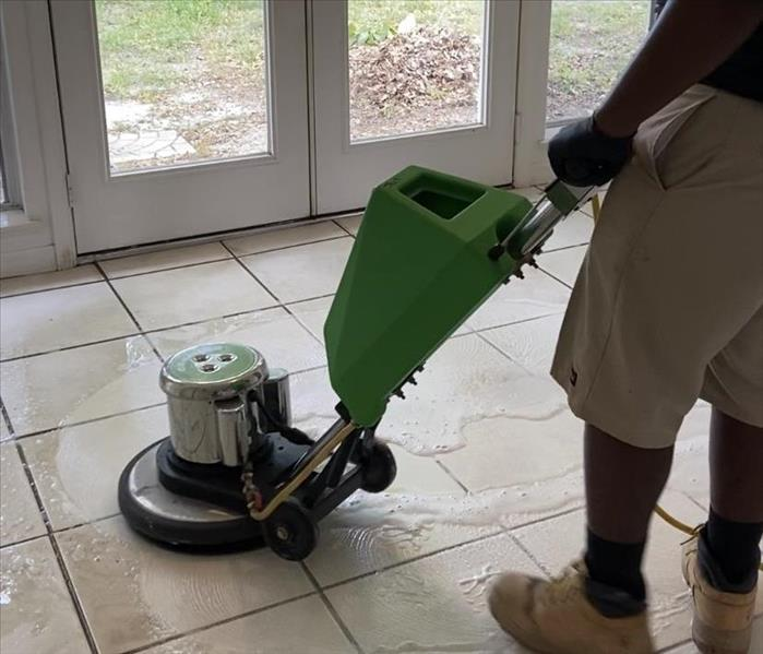 Technician Cleaning Tile