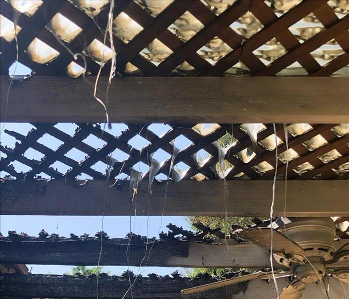patio overhead with fan, plastic cover has melted through