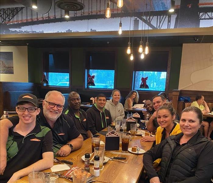 SERVPRO employees gathered around a table for lunch