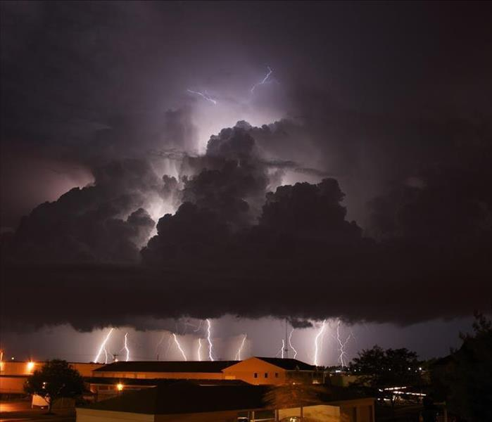 Night time image of a lightning storm above a residential area