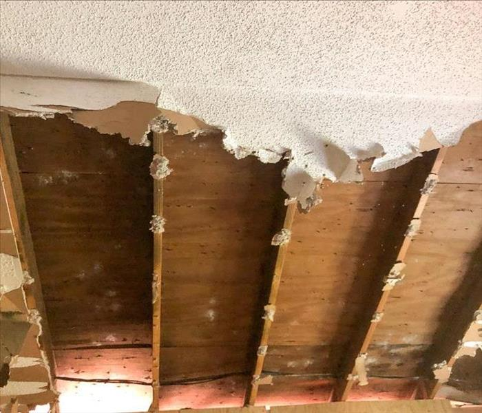 Ceiling and drywall torn out of a bedroom
