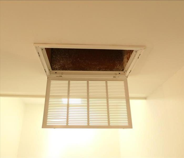 Return vent on ceiling in house opened up after duct cleaning